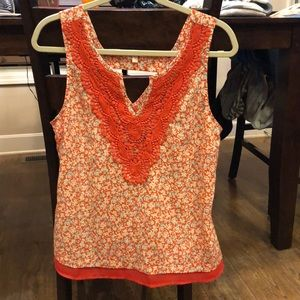 Orange with white and teal blouse